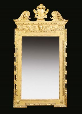 A carved giltwood pier mirror,