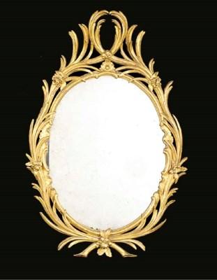 A George III giltwood oval mir