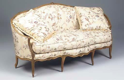 A Louis XV walnut canape