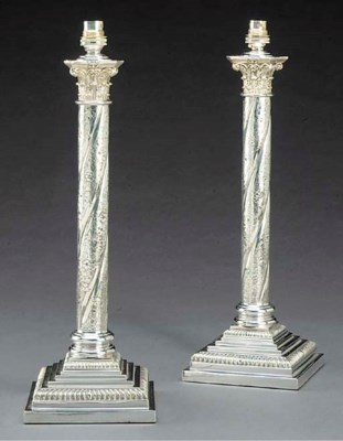 A pair of silver plated table