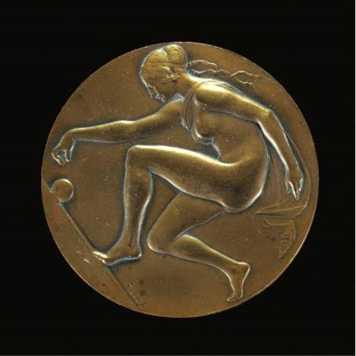A patinated bronze medal