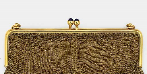 A gold mesh evening bag with p