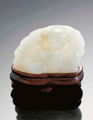 A white jade carving of a boy,