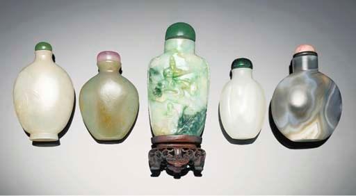 A carved jadeite snuff bottle,