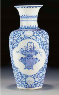 A blue and white tapering vase