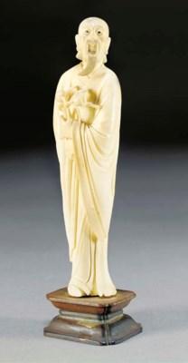 An ivory model of a bearded ma
