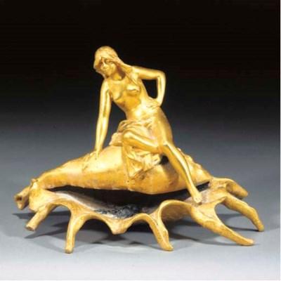 An Art Nouveau gilt and cold-p