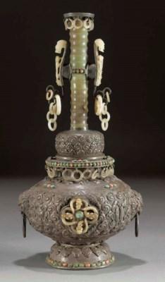 A Mongolian white metal vessel