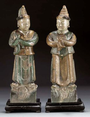 A pair of Ming green and ochre