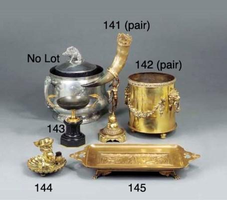 A brass desk standish cast wit