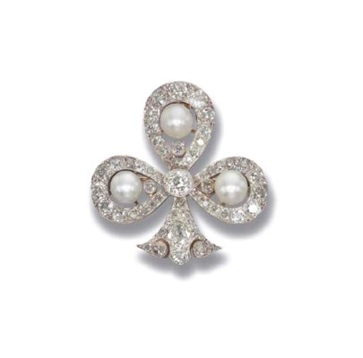 AN ANTIQUE DIAMOND AND NATURAL