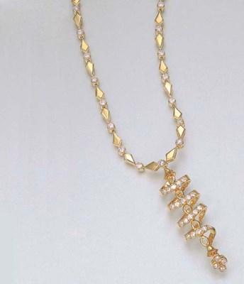 A DIAMOND AND 18K GOLD PENDANT