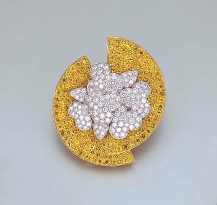 A DIAMOND AND YELLOW SAPPHIRE