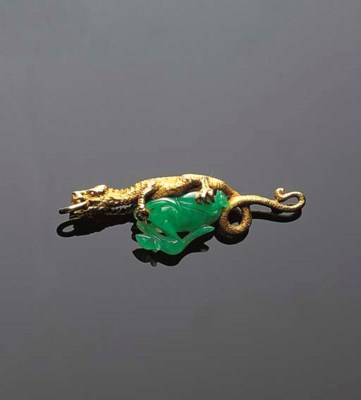 A JADEITE CARVING AND GOLD PEN