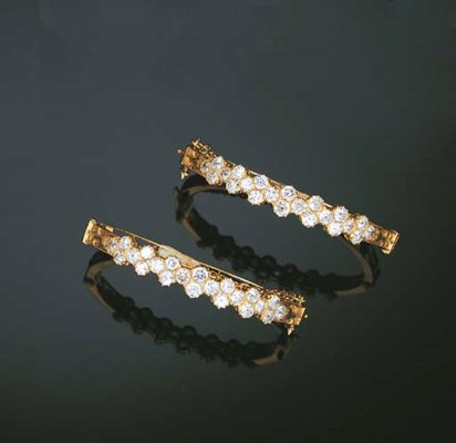 A PAIR OF DIAMOND BABY BANGLES