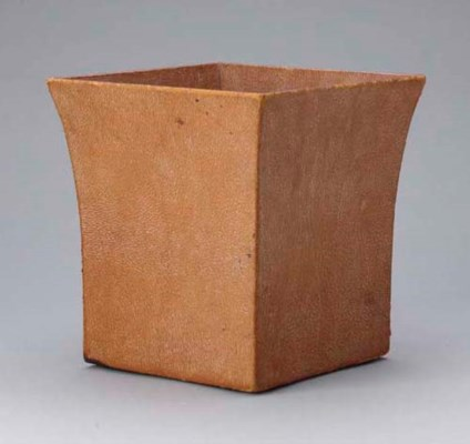A LEATHER COVERED WASTE PAPER