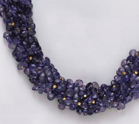 A SEVEN-STRAND IOLITE BEAD AND