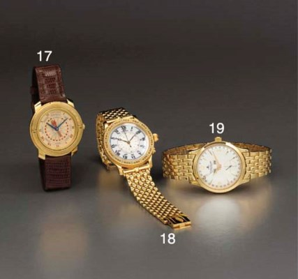 Longines. An 18K gold hour ang