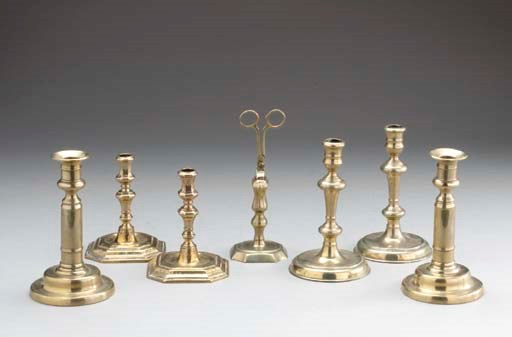 A GROUP OF BRASS CANDLESTICKS