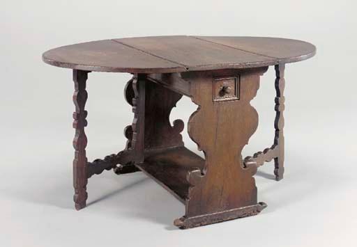 A SPANISH OAK DROP-LEAF TABLE,
