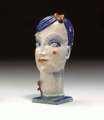 A GLAZED CERAMIC HEAD