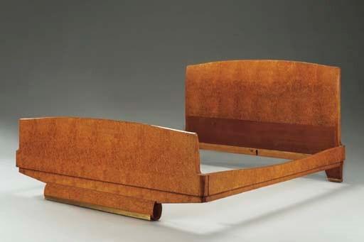 AN AMBOYNA AND GILT-BRONZE BED