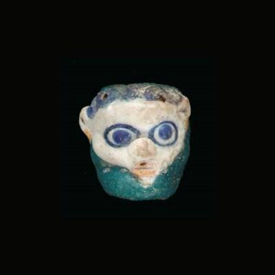 A CARTHAGINIAN GLASS HEAD PEND
