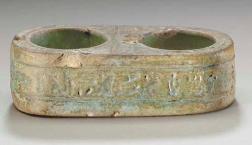 AN EGYPTIAN FAIENCE VOTIVE SCR