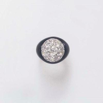 A DIAMOND AND ENAMEL RING