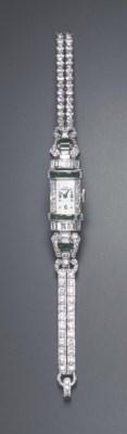 A DIAMOND AND EMERALD WRISTWAT