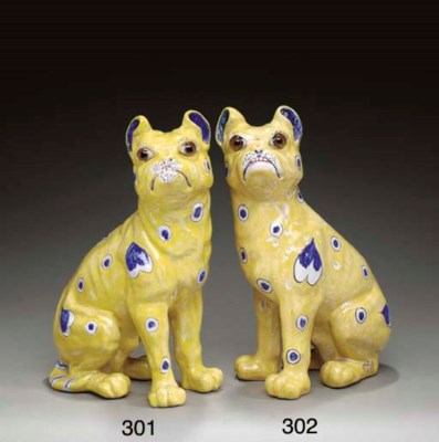 A FAIENCE FIGURE OF A PUG DOG