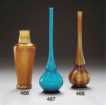 A STRIATED BROWN FAVRILE GLASS