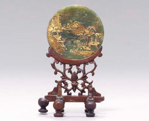 A CHINESE GILT-DECORATED JADE