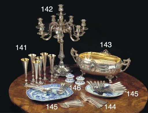 A silver eight-light candelabr