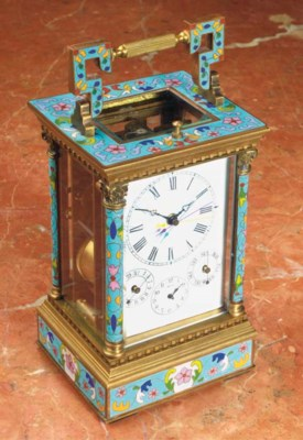 A brass and cloisonne clock wi