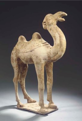 A red pottery figure of a came
