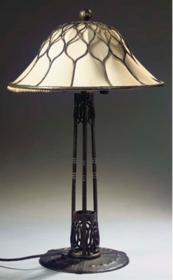 A wrought iron table-lamp