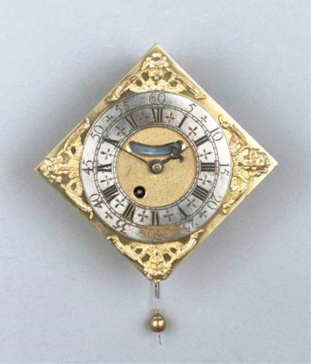 A miniature brass wall clock