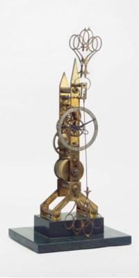 A brass skeleton timepiece wit