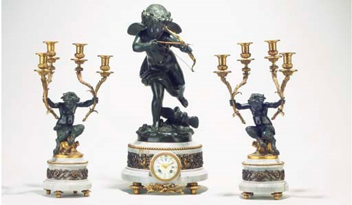 (3)  A French ormolu, patinate