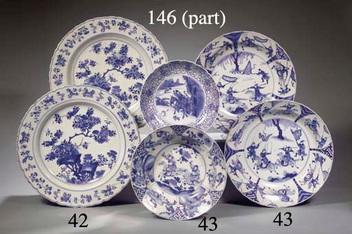 A set of four blue and white d