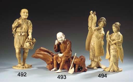 An ivory and wood okimono