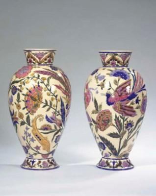 A pair of gilt and glazed pott