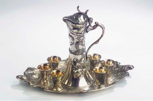 (8)  A silvered metal liqueur
