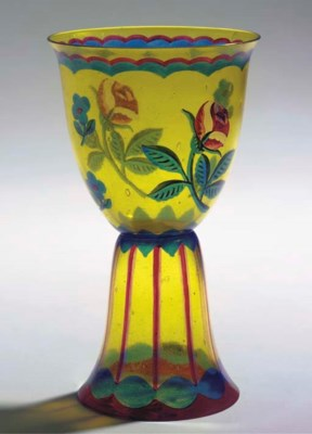 An enamelled yellow glass vase
