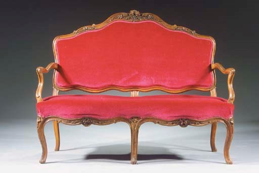 A Louis XV carved walnut canap
