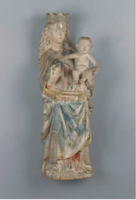 A polychrome carved and giltwo