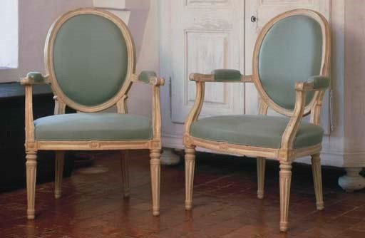 A PAIR OF LOUIS XVI CREAM AND