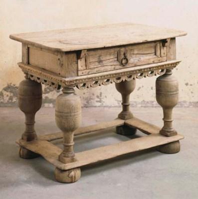 A GERMAN OAK SIDE-TABLE