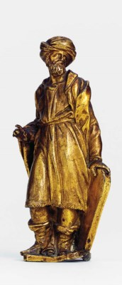 A GILT-BRONZE FIGURE OF A TURK